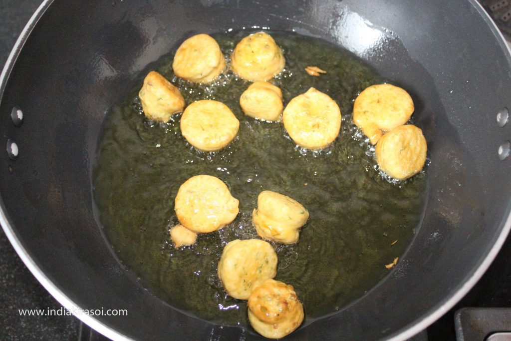 Fry the pakora's/dumplings from both the sides till they turn light brown.