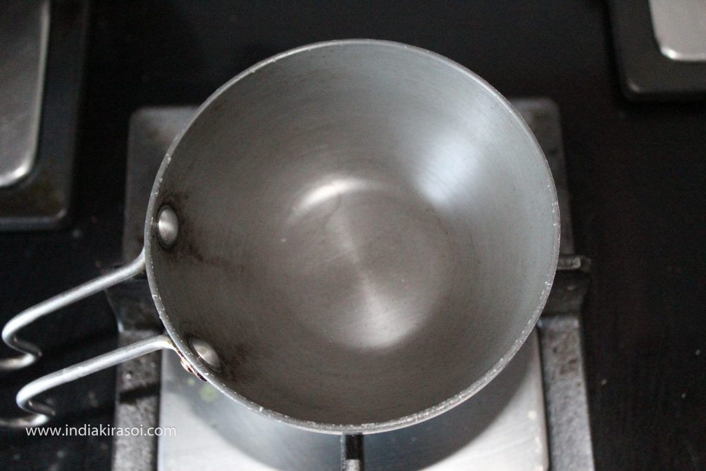 Now on another gas, place a tadka pan/ tempering pan on the gas.