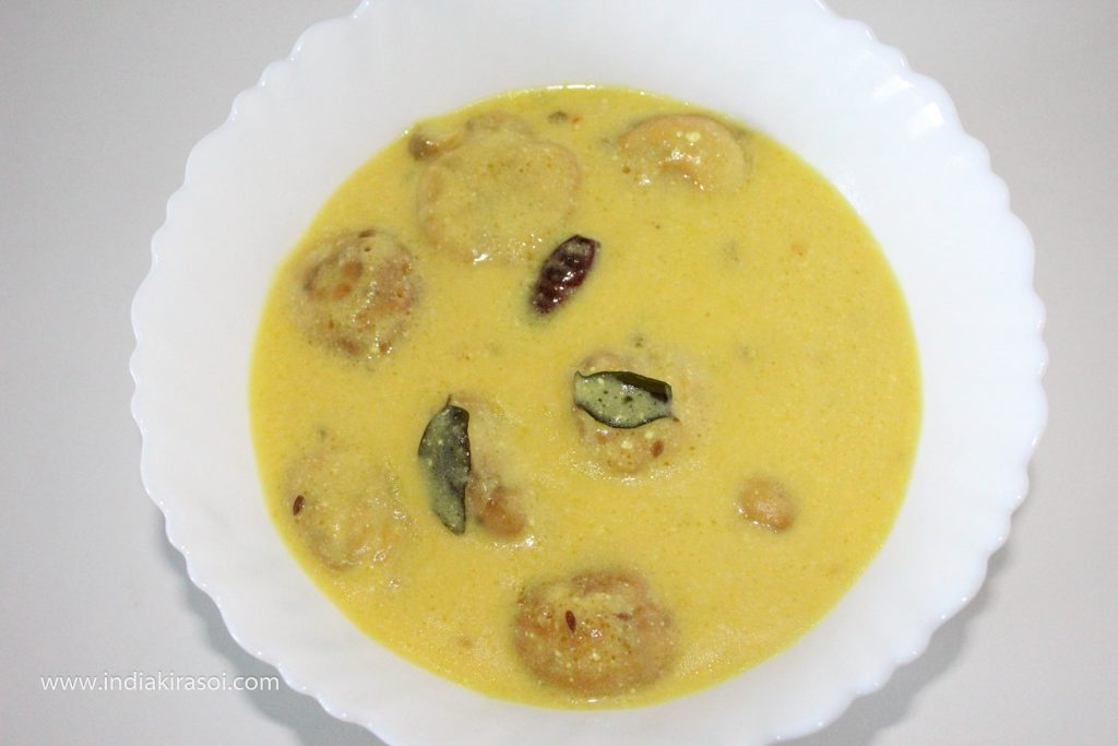 Serve with green coriander leaves and desi ghee tadka over the curry.