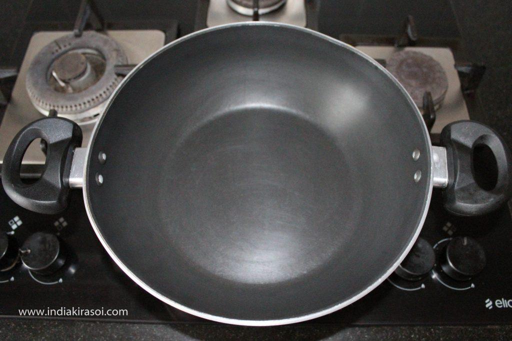 Put a kadhai/ fry pan on the gas.