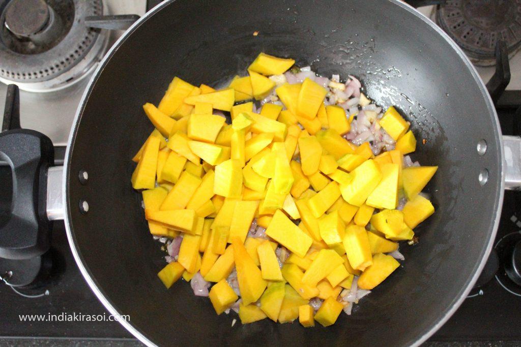 Now add chopped pumpkin to the kadhai/ fry pan.