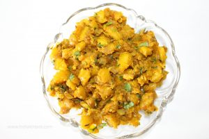Serve the pumpkin vegetable with roti, paratha or puri.