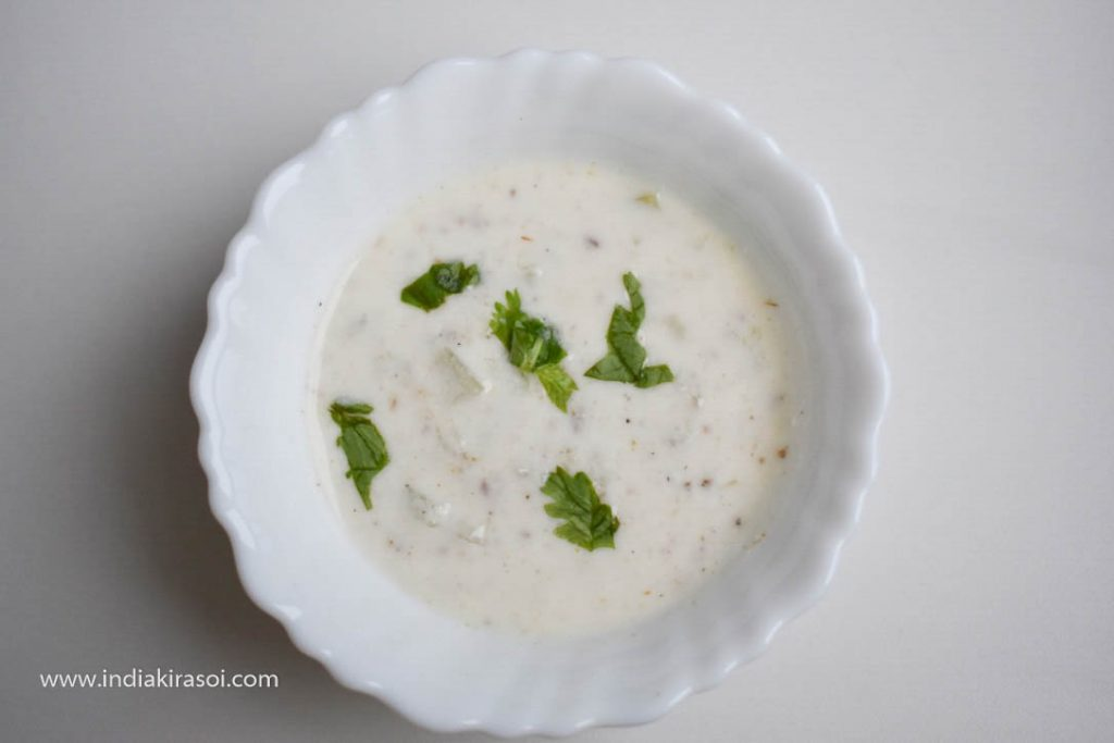 Serve Bottle gourd raita with dal, rice or paratha, and roti.