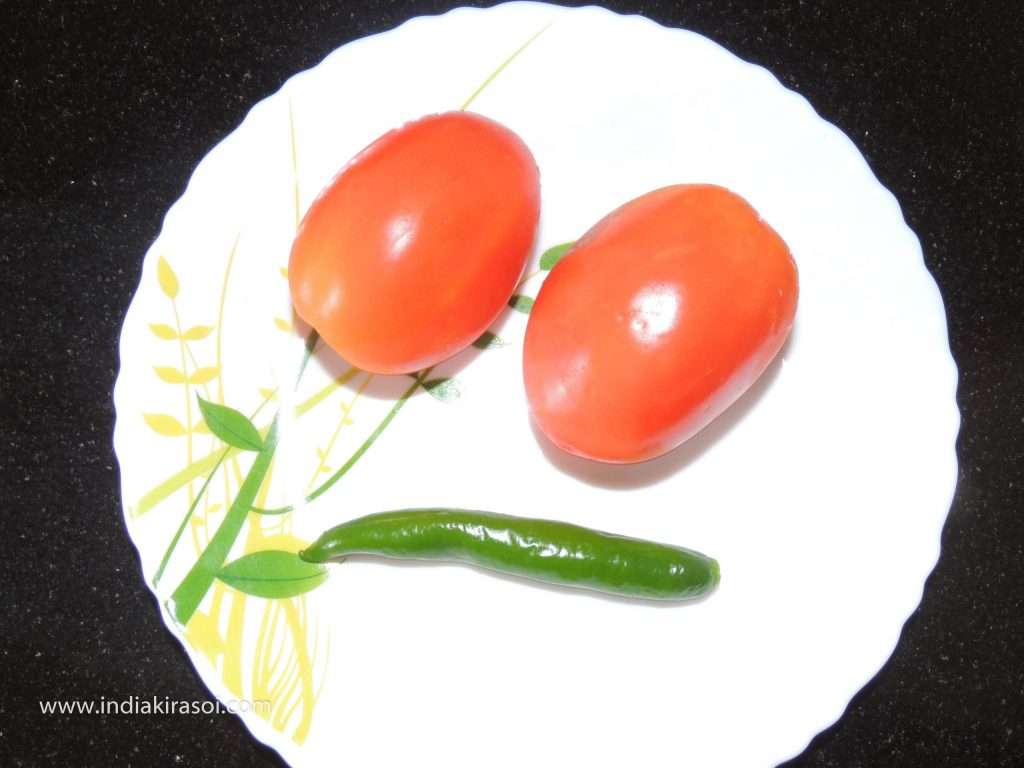 Now take two tomatoes, one green chilli.