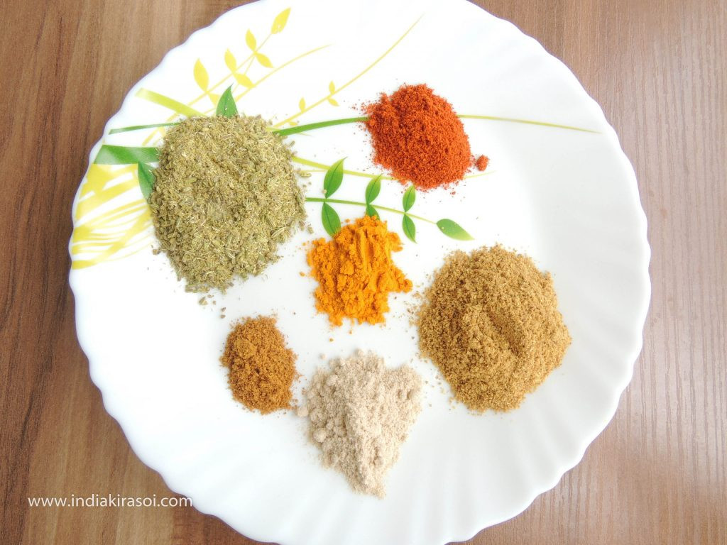Take one teaspoon turmeric powder, one teaspoon Amchur powder, one teaspoon red chili powder, half teaspoon roasted cumin powder with it.