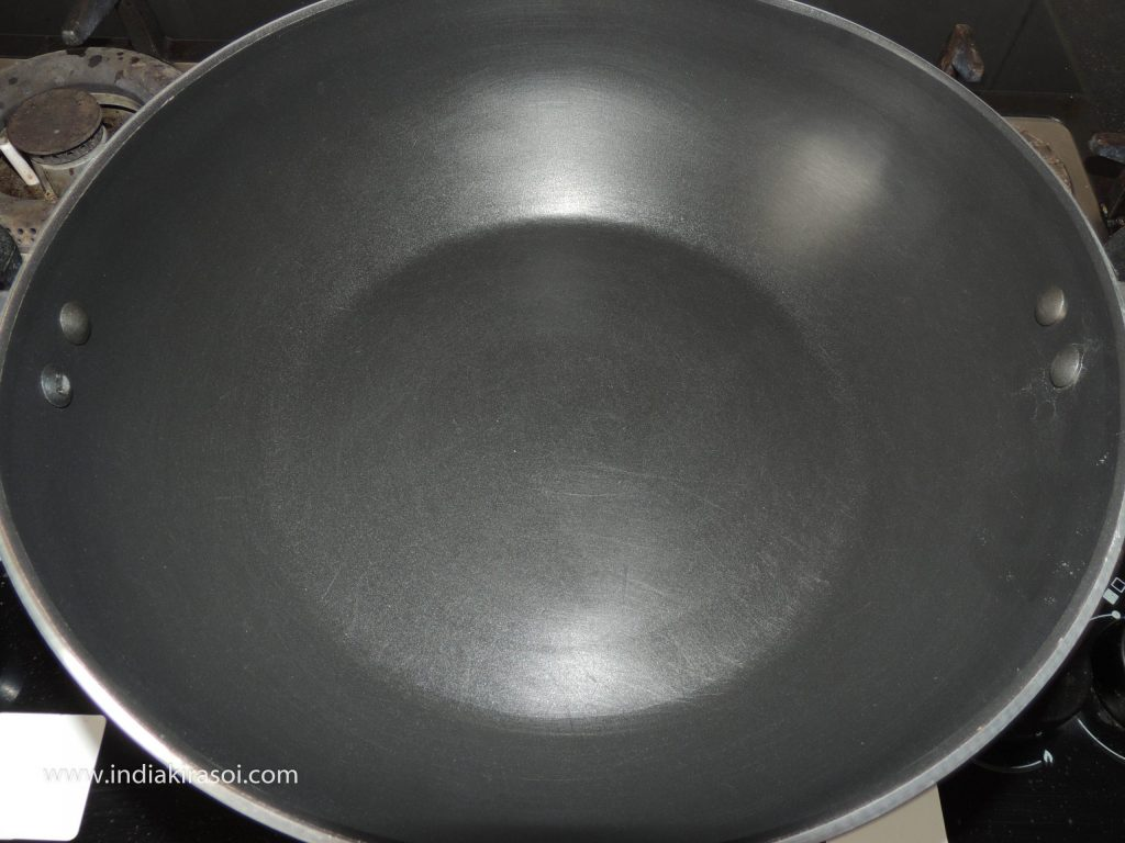Put the gas on the kadhai/ fry pan.