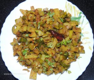 Add chopped coriander to the recipe of parwal potatoes.