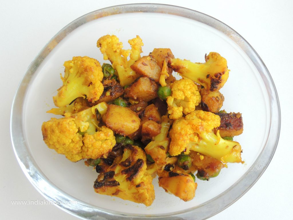 Take out the cauliflower potato dry vegetable in a separate bowl.
