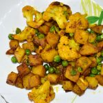 Take out the Punjabi cauliflower potato dry vegetable in a separate bowl.