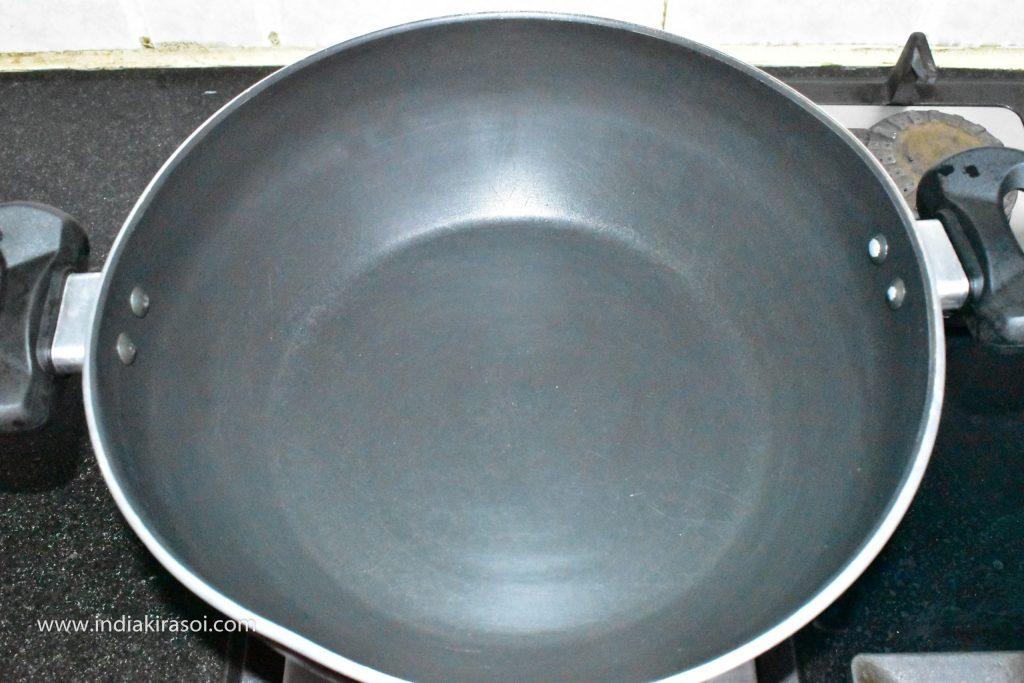 Put a kadhai/fry pan/cauldron on the gas.