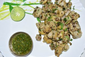 Take out the fried colocasia /ghuiyaan or arbi in a plate.