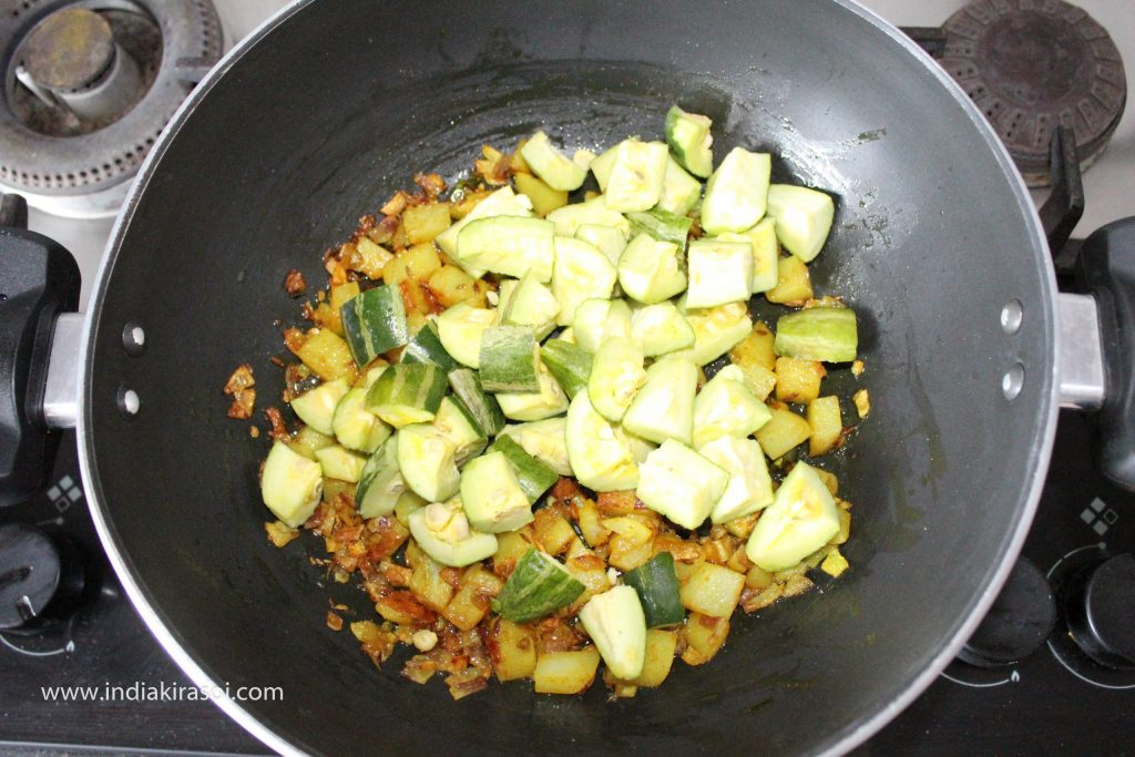 When the potatoes are cooked, add chopped pointed gourd/ parwal to the potatoes.