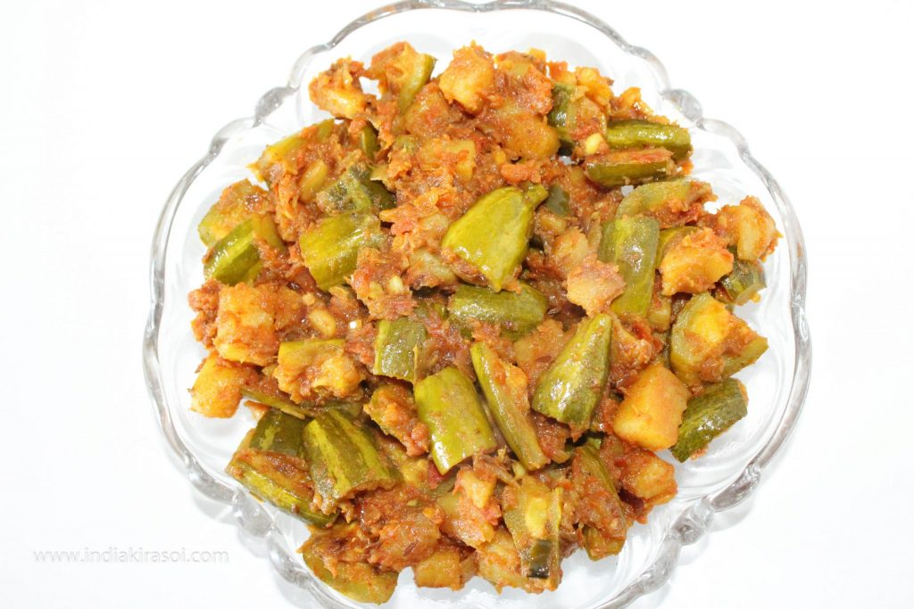 After frying, take out the dry tomato pointed gourd/ parwal potatoes recipe in a bowl.