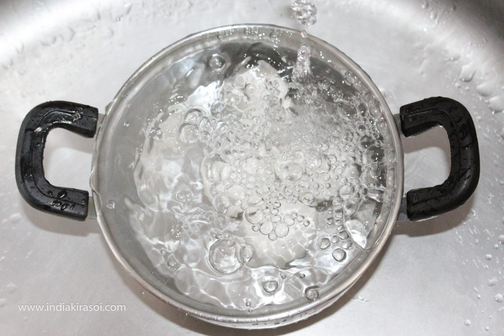 Remove the hot water from the vessel and pour cold water from the tap into the vessel.