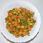 Serve the vegetable hot. Eat a mix vegetable of carrots, peas, tomatoes, potatoes with roti, paratha or puri.