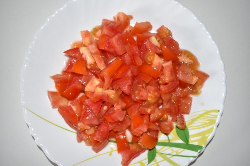 Take 3 medium sized tomatoes. Finely chop tomatoes.