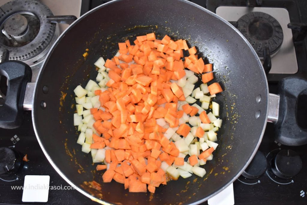 Then add chopped carrots in the kadhai/ fry pan.