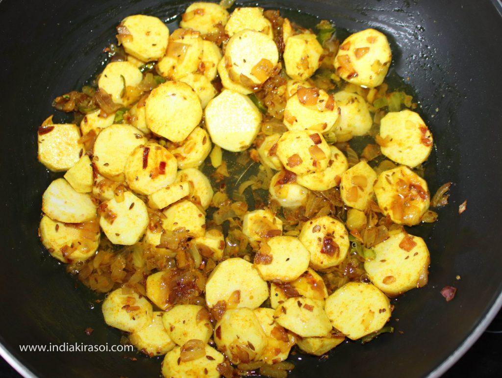 After this, add 150 grams or one cup of water in colocasia/ arbi or ghuiyan.