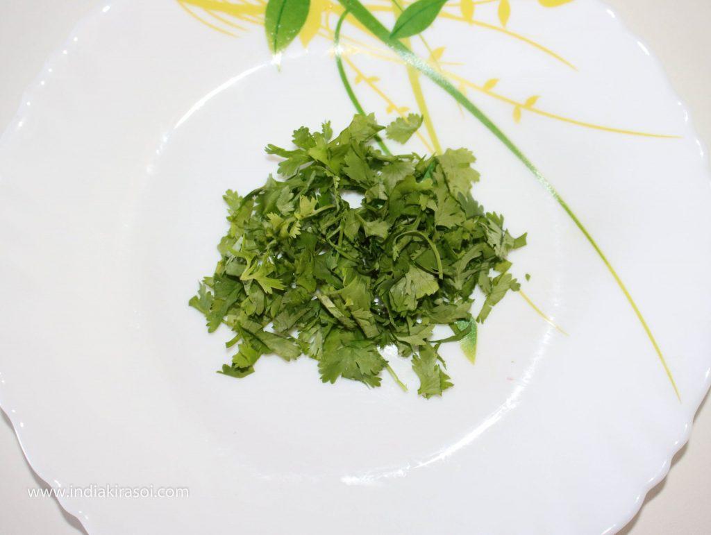 Cut 3 teaspoons green coriander leaves.
