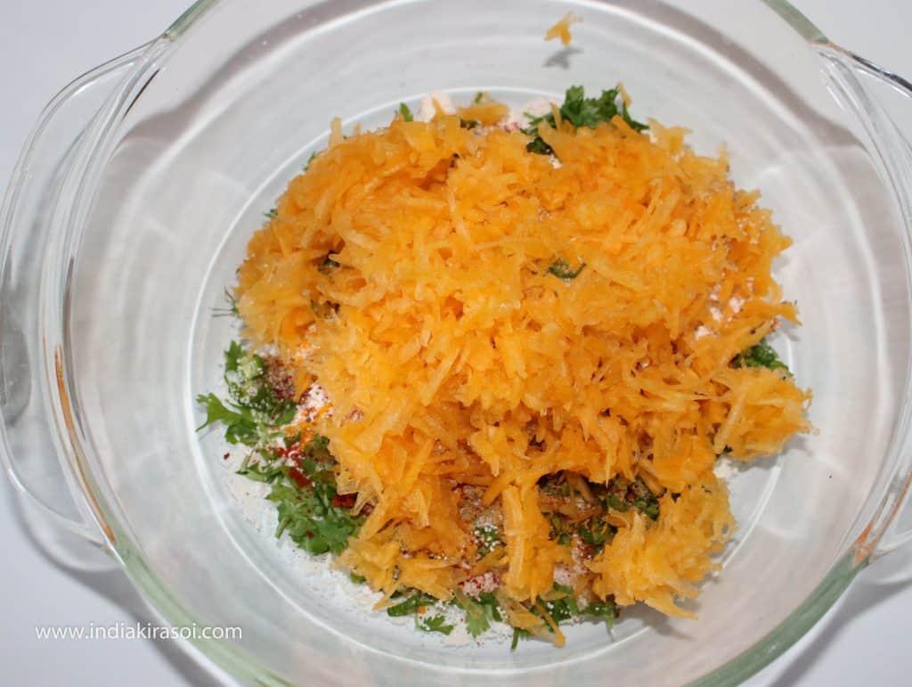 Add grated pumpkin/ kaddu over it.