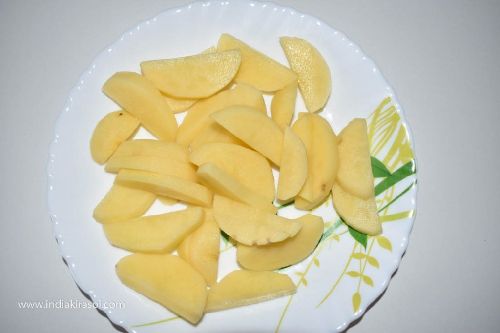 With 2 potatoes, peel the potatoes and wash them. Cut the potatoes into long slices.
