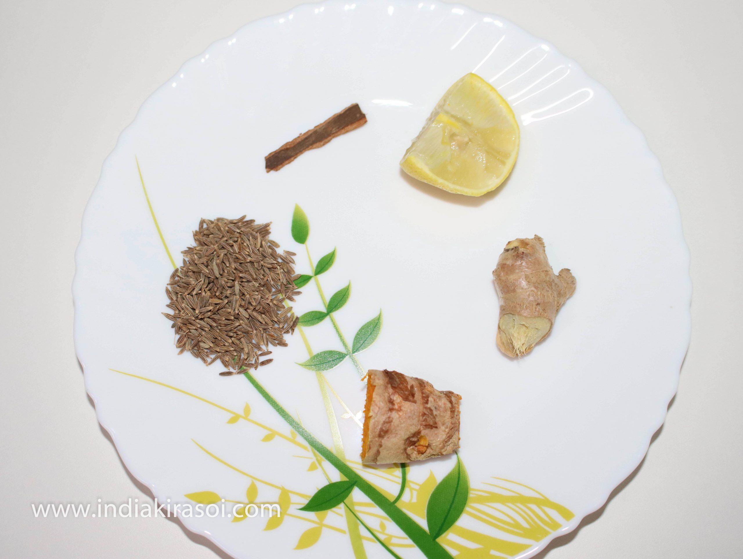 To make turmeric ginger cumin water, take 2-inch long raw turmeric, take one-inch long ginger, 2 teaspoon cumin, 2-inch long cinnamon, and half lemon.