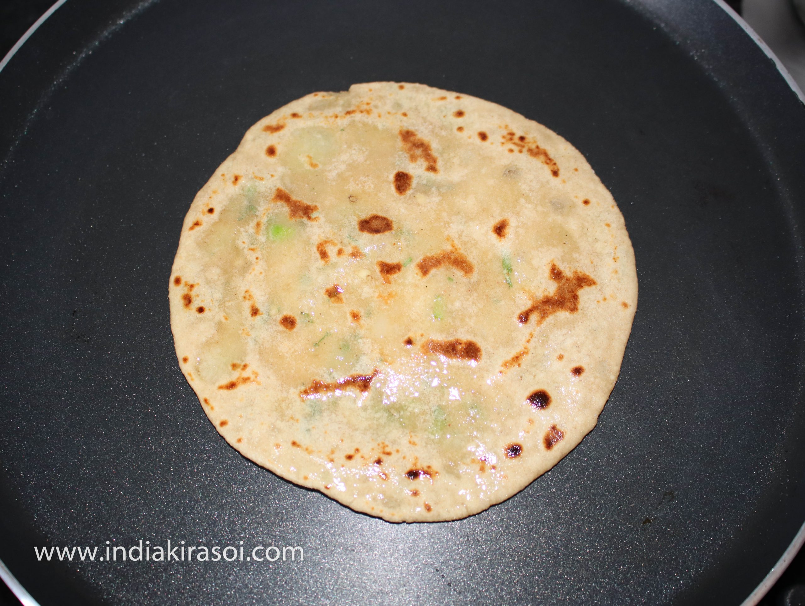 Apply the oil/ desi ghee o butter and apply on the flatbread/ paratha.