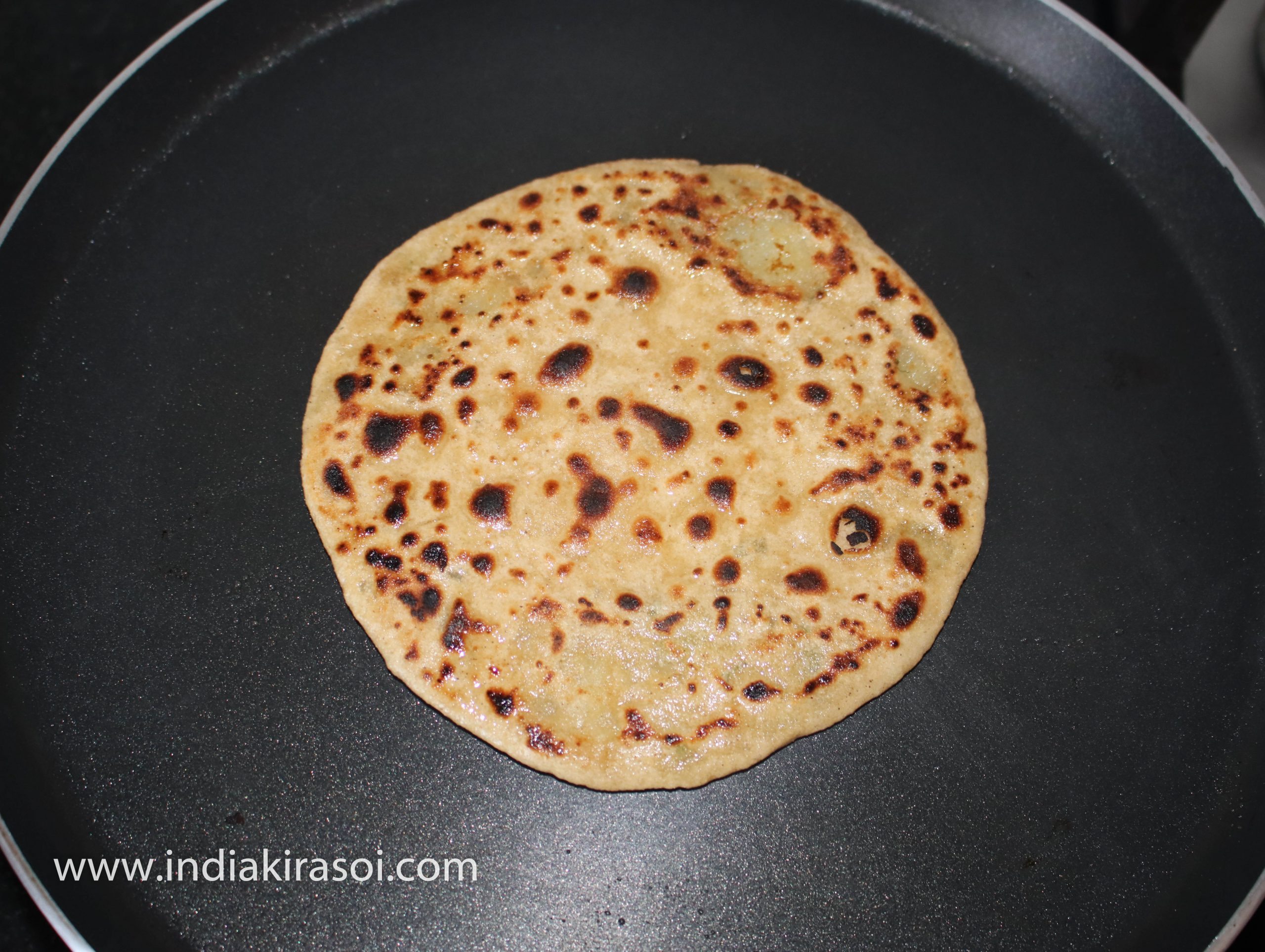 Cook flatbread/ paratha on both the sides.