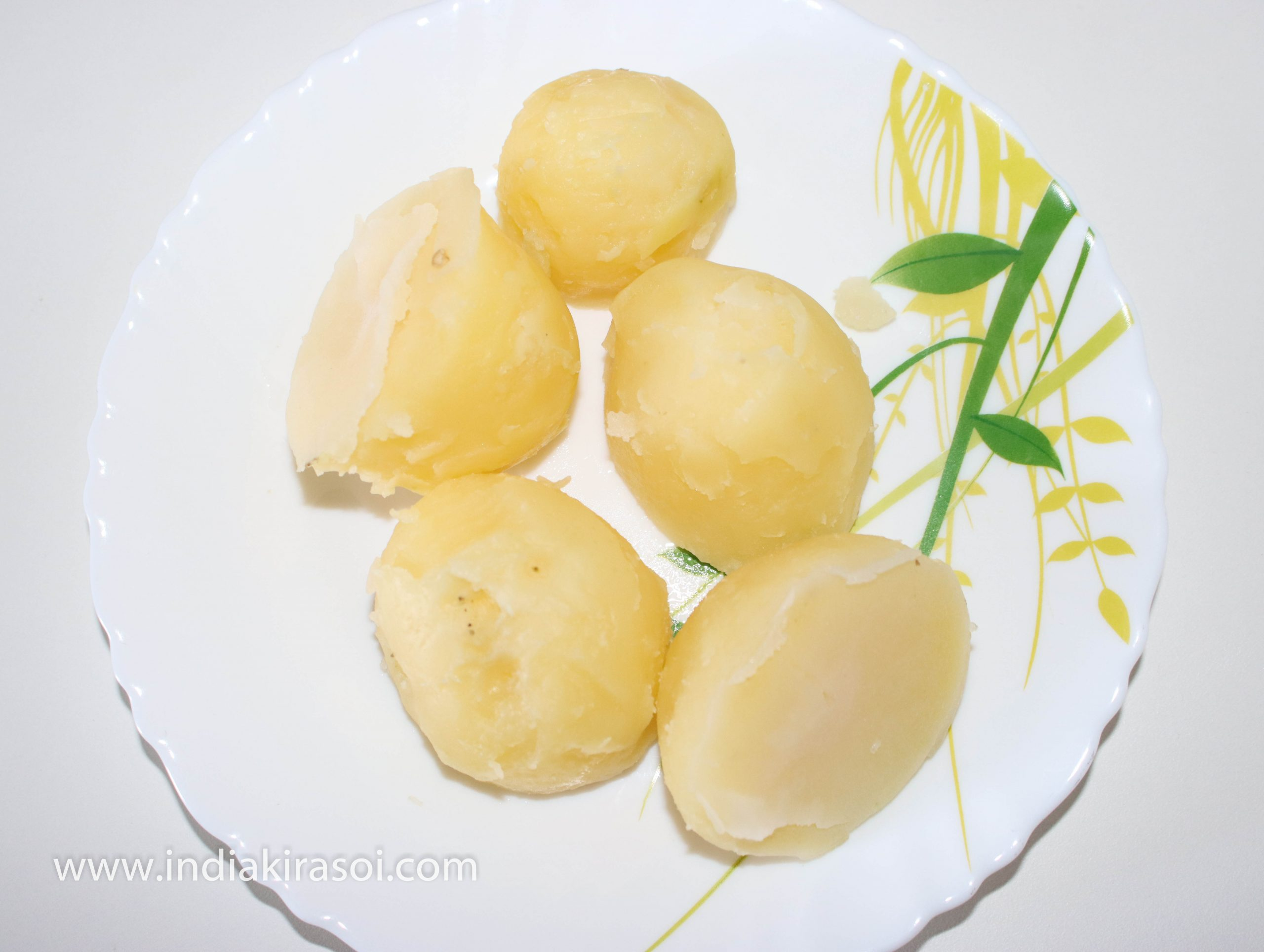 Now we will make potato stuffing. For that we will take 200 grams of potato and boil them on the two whistle of pressure cooker. Once the gas released from the pressure cooker. Open the pressure cooker and peel the potato.